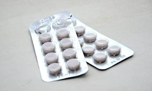 Лекарство выпускается в таблетках. Форма таблеток — плоский цилиндр, имеющий фаску